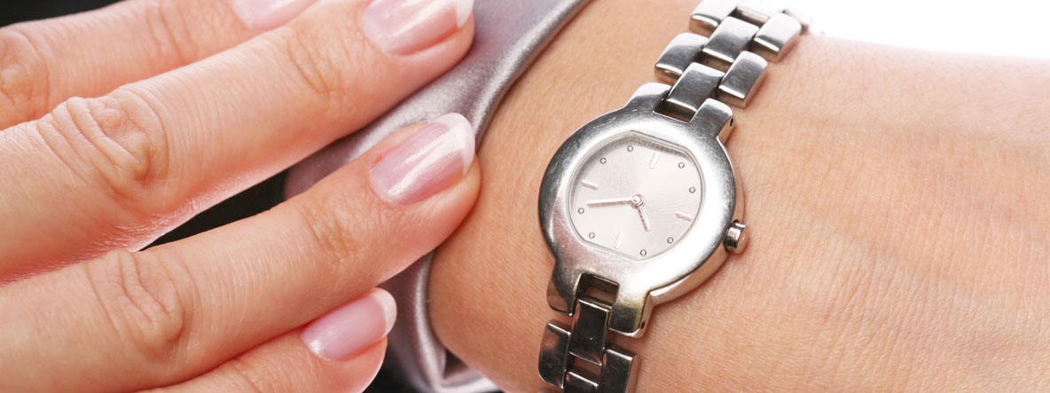 Businesswoman looks at his watch