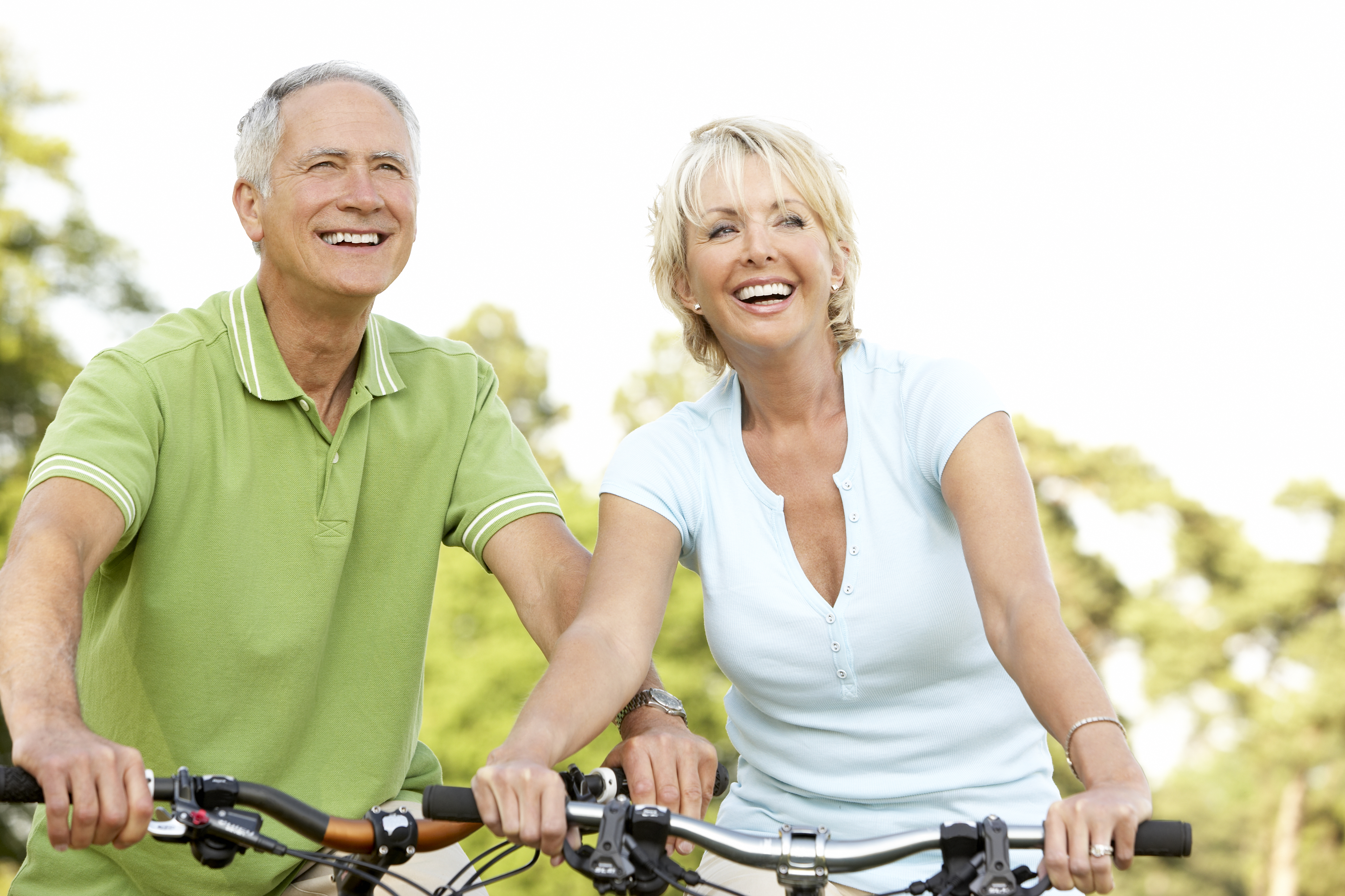 Mature couple riding bikes