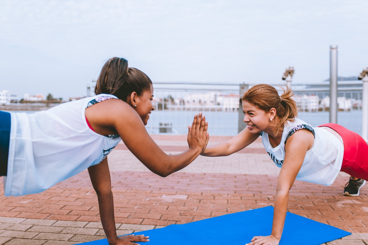 two-woman-doing-exercise-1671217