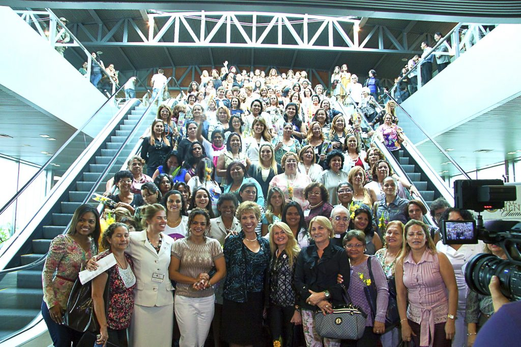 Dr. Paula Fellingham and Global Women's Summit attendees in the airport